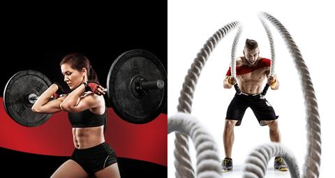 Woman lifting barbell, man using rope for cross fit