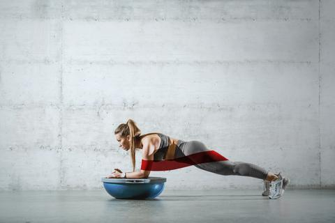Photo of a woman doing a plank exercise