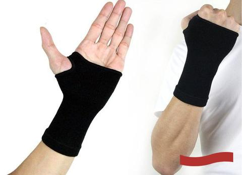 photo of a man's hand wearing a wrist compression sleeve