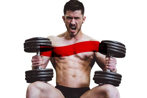 Man sitting down and holding two dumbbells
