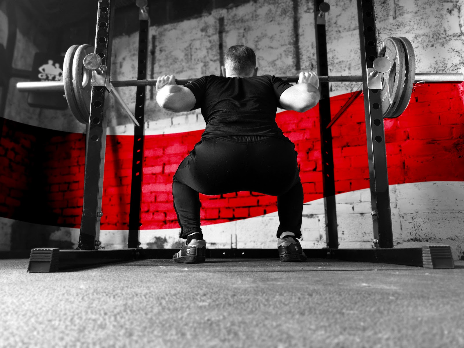 Image of weightlifter in squat position from the back