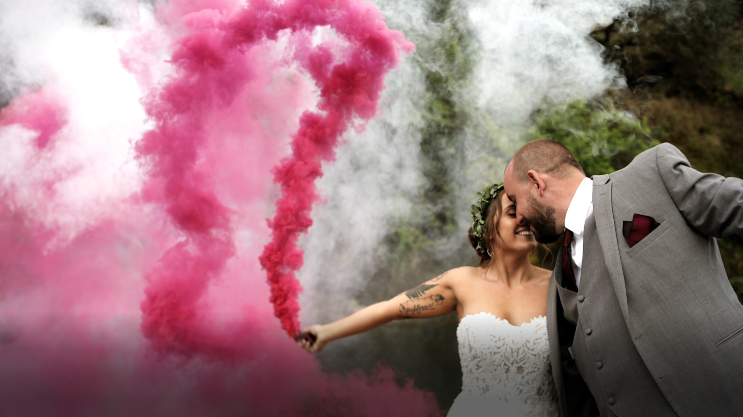 Husband and wife holding smoke bombs in Chico, Ca