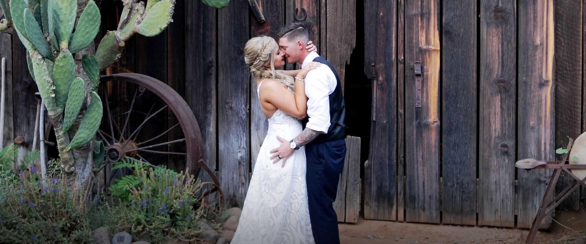 Bride and Groom Hugging in front of Barn at the White Ranch Events Venue in Chico, Ca