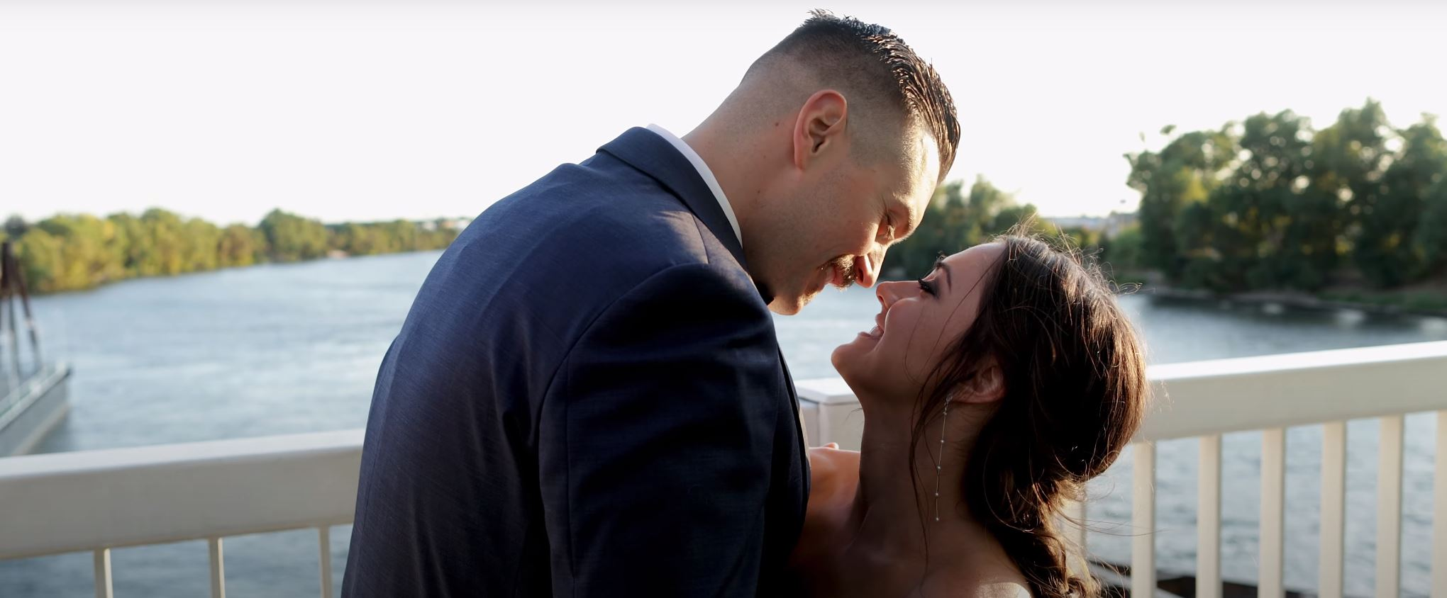 Bride and Groom embracing on the Tower Bridge in Sacramento, Ca