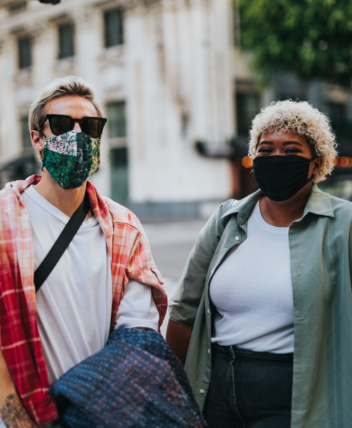 Two young people wearing masks