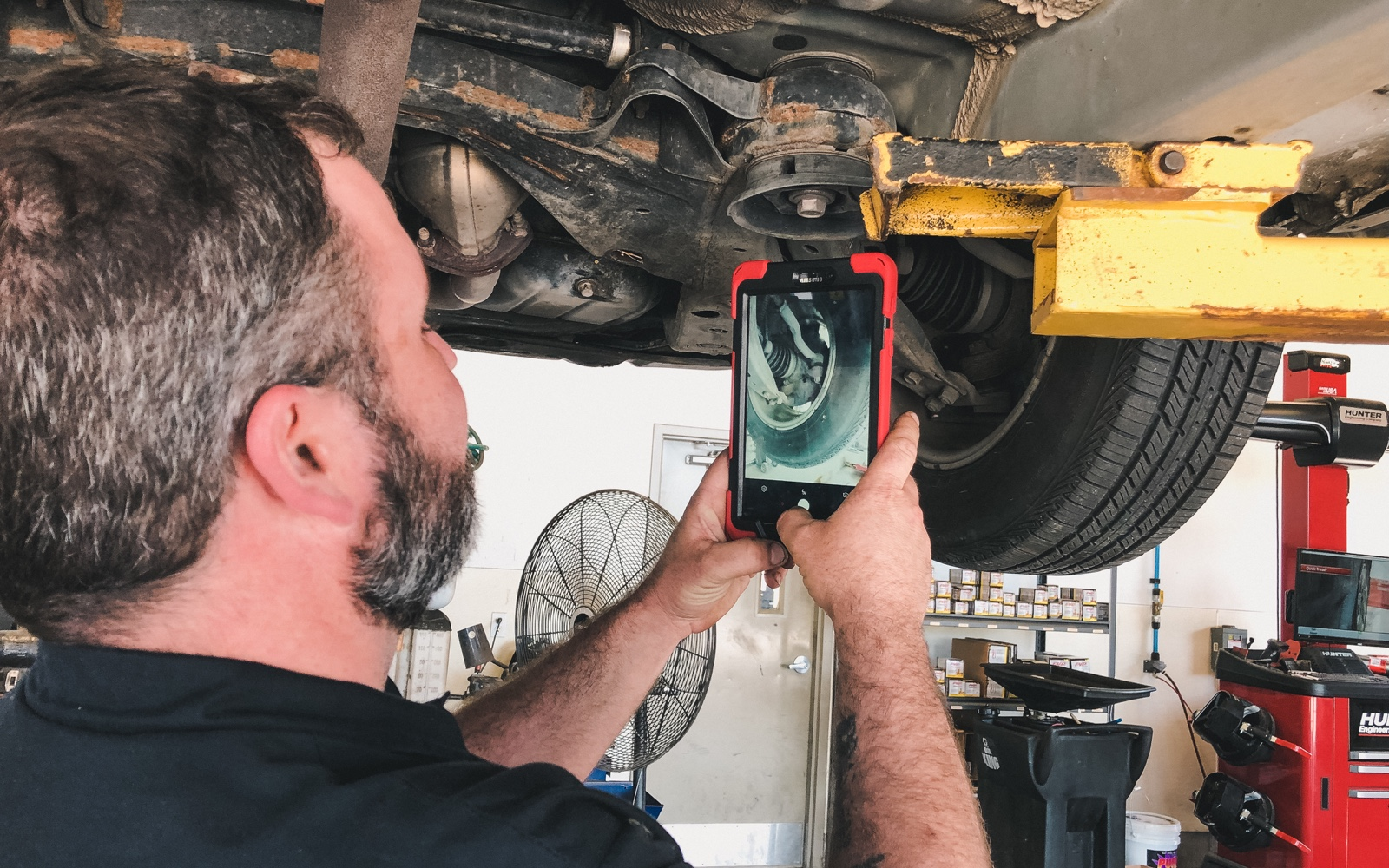 An image of one of Gateway Auto's technicians preparing a digital inspection