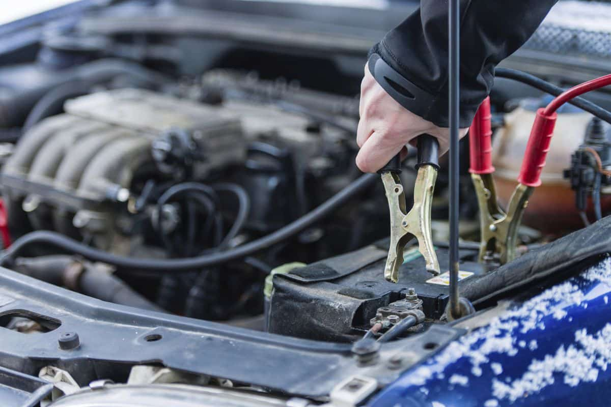 An image of a service professional working on a car