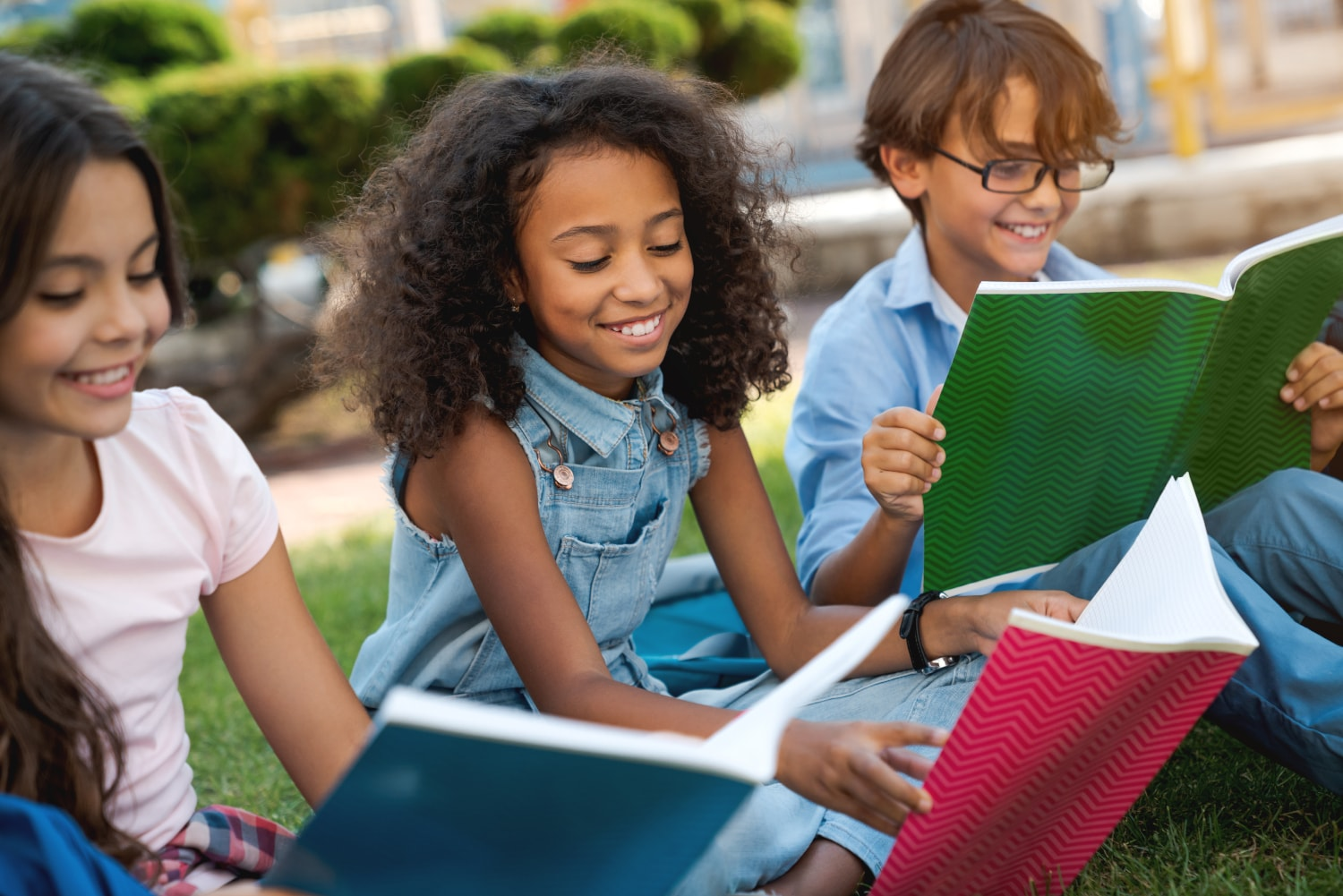 group of students reading outside together