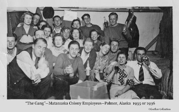 Image shows a group of young men and women gathered and relaxing in one of the tents associated with the Matanuska Colony Project. Most were employees of the Alaska Rural Rehabilitation Corporation (ARRC) which managed the project.