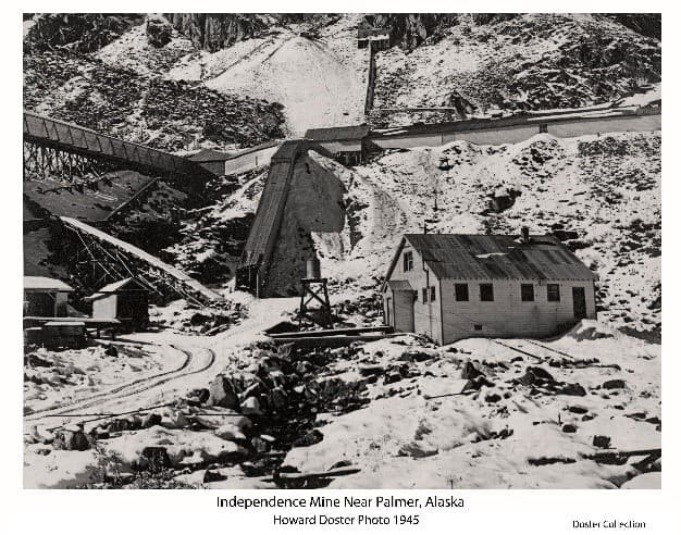 Image is a major portion of the large print showing tailing dumps, buildings, covered stairways and corridors, and other structures on the Independence Gold Mine facility as it appeared in 1945.