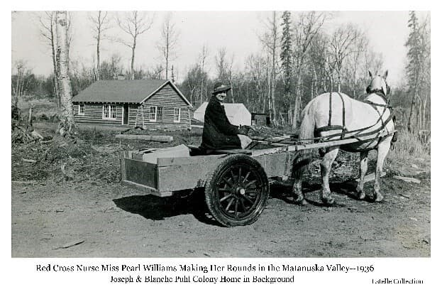 Image shows a woman, identified as Miss Pearl Williams, Red Cross Nurse, in a cart pulled by a white horse. A log House, identified as the home of colonists Joe and Blanch Puhl, is in the background. A tent is also visible.