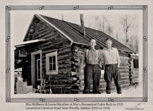 """Image shows two men, identified from left as """"Mac"""" McHenry and Louis Odsather, standing in front of Mac's homestead cabin. Mac's homestead was south of Wasilla in vicinity of Fairview Loop.  Louis Odsather was Trading Post manager for the ARRC."""