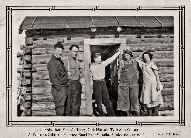 Image shows four men and a woman, identified from left as Louis Odsather, Mac McHenry, Nick Nichols, Ty Wilson, and Ann Wilson. They are standing in front of Wilson's homestead cabin.