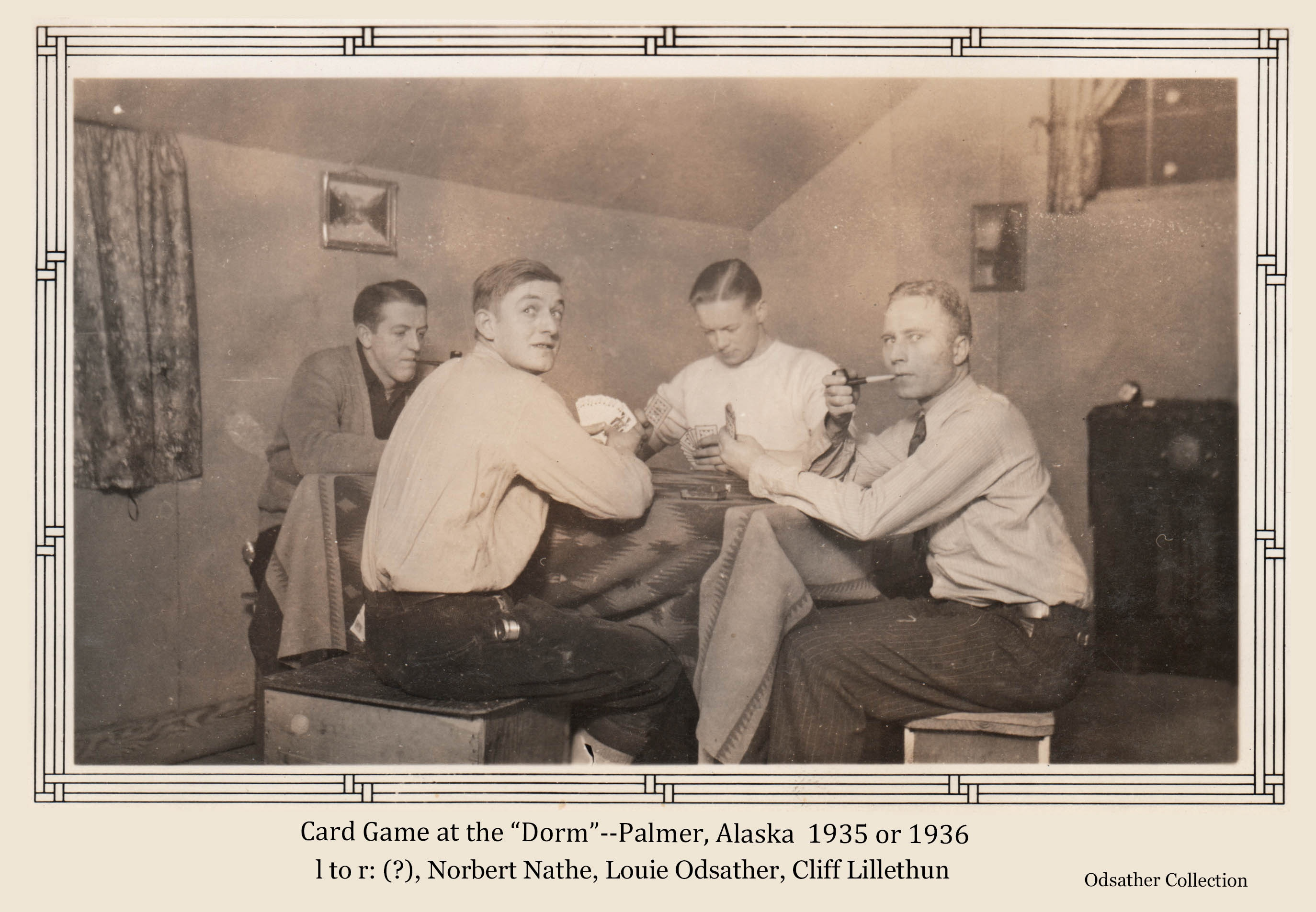 """Image shows four men, identified from left as, unidentified, Norbert Nathe, Louis Odsather, and Cliff Lillethun, playing cards at a table covered with an Indian blanket. The men were employees of the ARRC. The home is identified as that of """"Nick"""" and Fran Nichols in Palmer, also ARRC employees."""