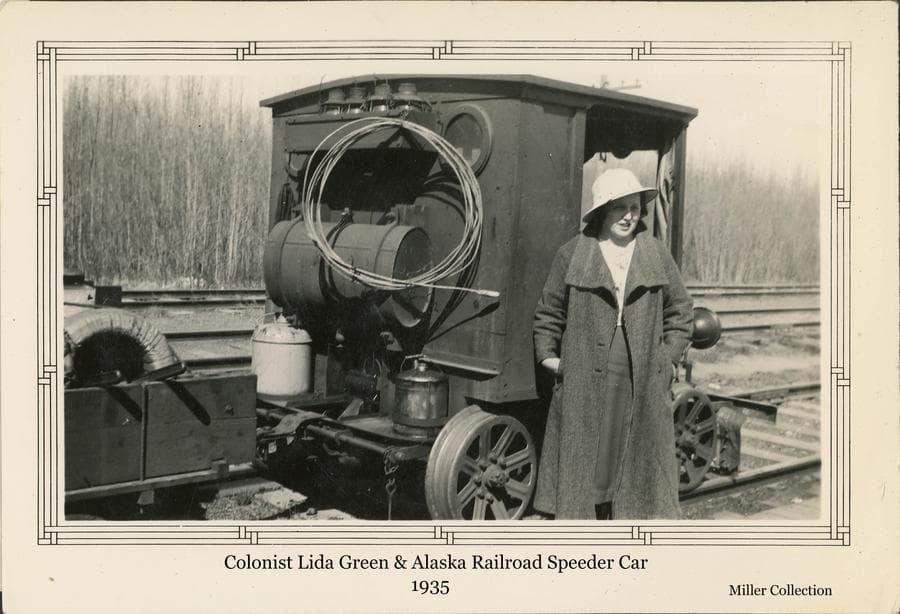 "Image shows a woman, identified as colonist Allda (""Lida"") Green, standing next to a railroad ""speeder"" car."