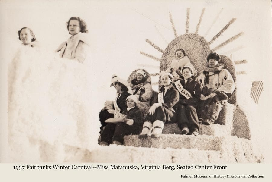 """Image is of a parade float at the 1937 Fairbanks Winter Carnival.  Several women and one man are riding on the float.  Miss Virginia Berg of Palmer is riding on the float as the """"Miss Matanuska"""" entry in the festival Queen contest, seated in the center front."""