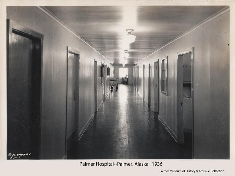 Image is of the hallway of the new hospital in Palmer.  Nurse Katheryn Powers is visible at the nurses station at the far end of the hall.