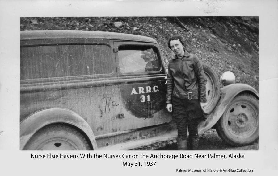 Image is of registered nurse Elsie Havens standing beside the nurse's car along the road between Palmer and Anchorage.  The car, identified as A.R.R.C. vehicle #31, was available for use by the hospital nurses and was also used as the ambulance as needed.