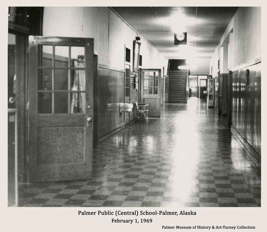 Image is a view of the interior hallway of Palmer Central School as it appeared on February 1, 1969 at 1:18pm.  Note on the back of the photo refers to the school being evacuated, but gives no indication as to why.