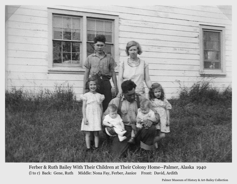 Image is of the Ferber & Ruth Bailey family taken next to their Colony house in summer of 1940.    Children are identified as Ferber Gene, Nona Fay, Janice, David and Ardith.