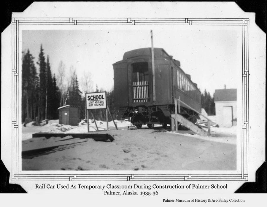 Image is a winter view of the rail car used as a classroom for Palmer's 1st & 2nd grades during the 1935-36 school year while the new Palmer school was under construction.