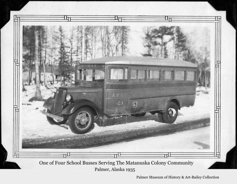 Image is a winter view of one of four school busses operated by the Alaska Rural Rehabilitation Corporation in administration of the Matanuska Colony Project.