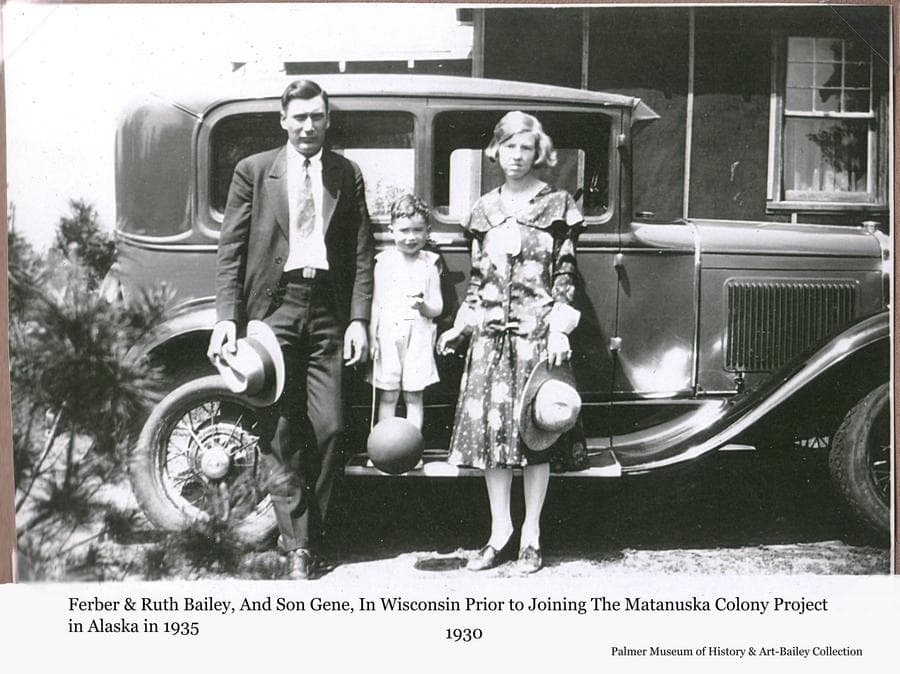 Image is of the Bailey family—Ferber, Ruth, and son Gene.  Photo taken in Wisconsin five years prior to moving to Alaska as part of the Matanuska Colony Project in 1935.  They are standing in front of a late model car with a tarpaper house behind.  For many of the Colonists the move to Alaska presented a dramatic change in social norms and life styles.  Considering the adornment of suit coat and tie evident in this photo, perhaps none more so than for Ferb Bailey.