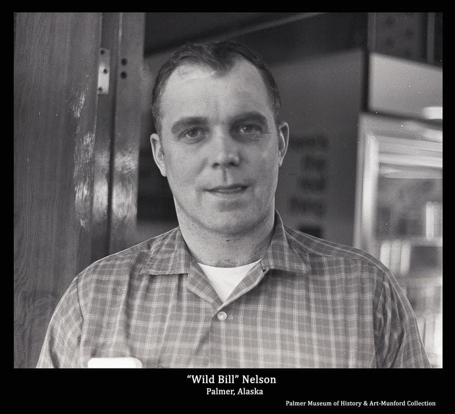 "Image is of ""Wild Bill"" Nelson at Bob's Barber Shop in Palmer.  Nelson grew up near Wasilla, Alaska and lived most of his life in the Valley.  He was a heavy equipment operator and contractor.  He was a very out-spoken and loudly opinionated character, known throughout the area for his low regard for attorneys and for his piloting stunts in small aircraft.  Many long-term Valley residents have ""Wild Bill"" Nelson stories they love to share."