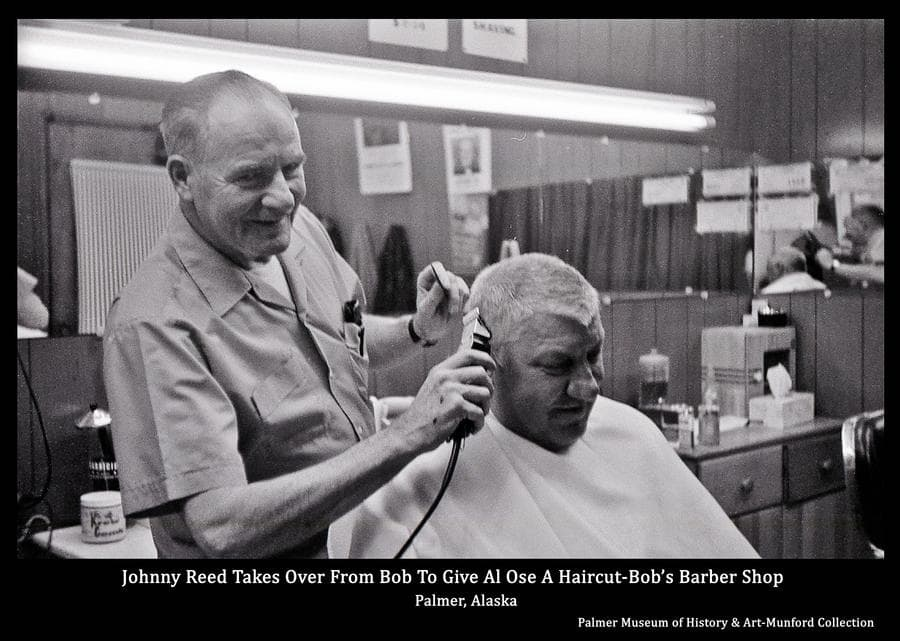 Johnny Reed appears to be giving Al Ose a haircut in Bob's Barber Shop