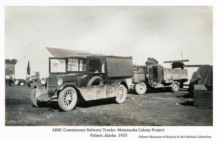 Image shows two trucks used to deliver commissary goods to Matanuska Colonists throughout valley.  Tents are visible behind the trucks.