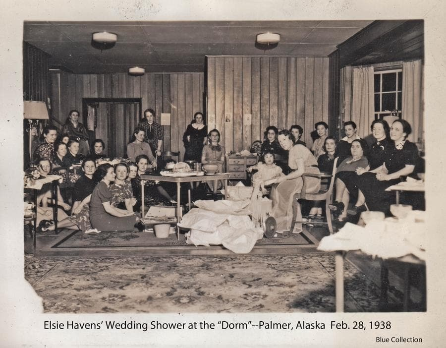 Image is of the wedding shower for Palmer hospital nurse Elsie Havens as she prepares to marry Walt Blue.  The setting is the living room of the singles dormitory in the Community Center and attendees include fellow nurses, teachers, corporation employees and other ladies of the community.