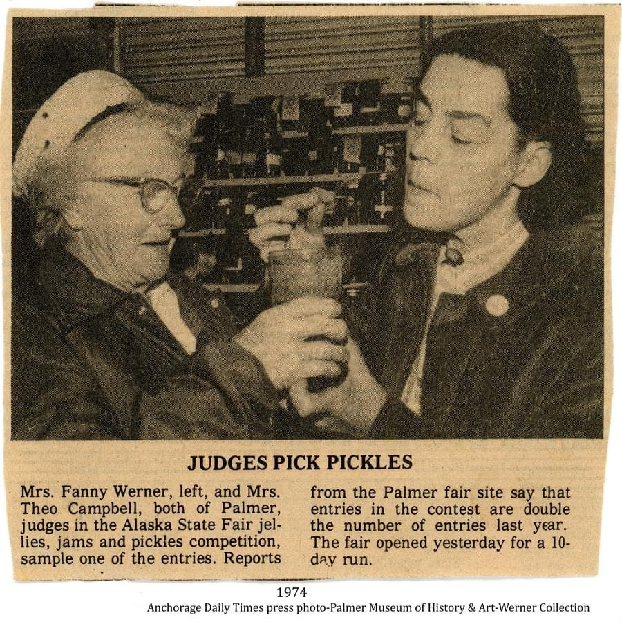 Fanny Werner, at left, for many years a prize-winning entrant of home canning goods at the fair, and valley resident Theo Campbell, are sampling an entry as they judge the jams, jellies and pickles competition at the 1974 Alaska State Fair in Palmer.