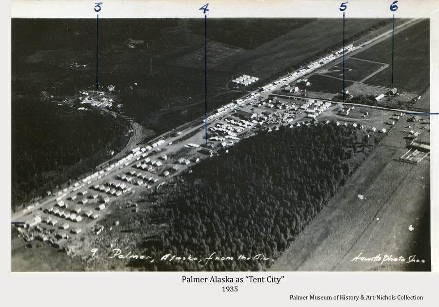 """Image is a high oblique view of Palmer in the summer of 1935 when it was often called """"Tent City"""" because of all the tents in place housing the Colonists and others associated with the Matanuska Colony project.  The numbers in evidence on the photo identify: #3-Trading Post; #4-Isolation Hospital; #5-General & Maternity Hospital; #6-Manager Don Irwin's Residence.  Homesteader John Bugge's fields are in the lower right and other homestead clearings within the heavy forest are apparent."""