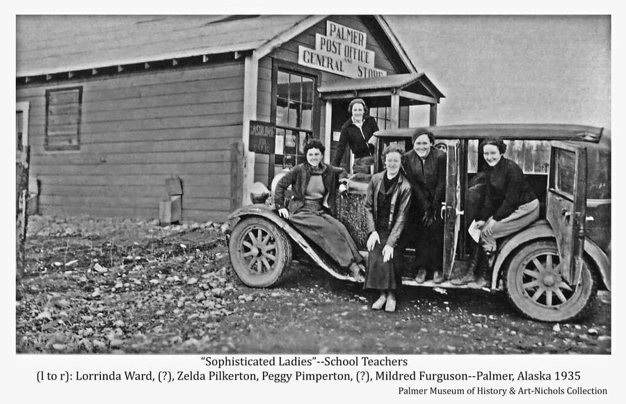 """Image shows six people gathered on a four-door car parked in front of a building identified by a sign on the front as """"Palmer Post Office, General Store"""".  Another sign advertises """"Gasoline For Sale"""".  Five women are apparent and identified as Palmer school teachers: (l to r) Lorrinda Ward, Unidentified, Zelda Pilkerton, Peggy Pimperton, Unidentified, and Mildred Ferguson.  An unidentified sixth person can be seen peeking through the car from the other side."""