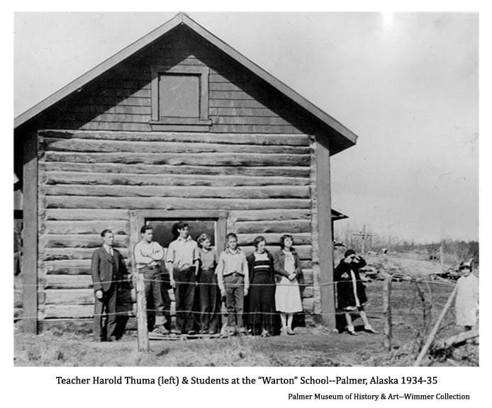 """Image shows school teacher, identified as Harold Thuma, and eight students standing near a two story log building identified as the school at the community of """"Warton"""", later named Palmer, Alaska."""