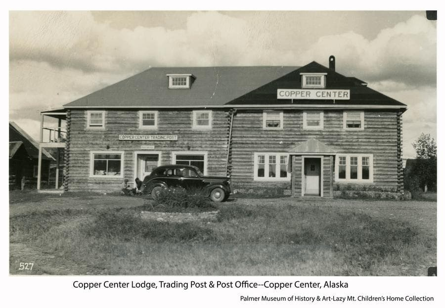 Image shows the front of the Copper Center Lodge as it appeared about 1947 when the Children's home was in the midst of moving their operation from Valdez to Lazy Mountain.  The lodge would have been a logical stop for them on the highway between the two communities. A car is parked in front of the building.  Fire destroyed the lodge in 2012.