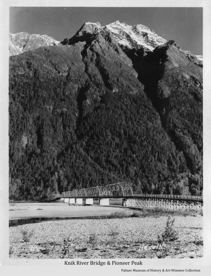 Image shows the highway bridge over Knik River on the old Glenn Highway between Palmer and Anchorage.  Pioneer Peak is prominent beyond.