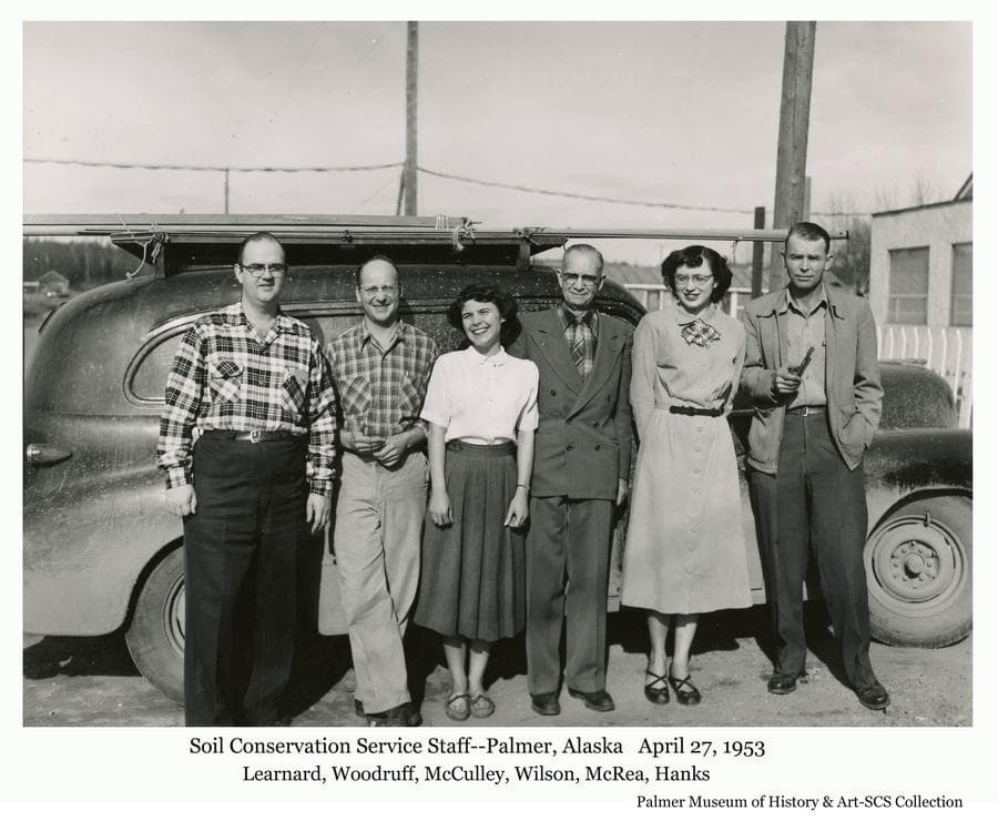 Image is of the Soil Conservation Service staff at the Palmer office posing in front of a car.