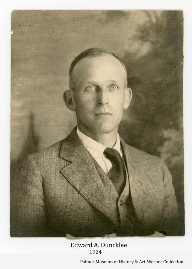 Image is a portrait of Edward Albert Duncklee, (1872-1943) Palmer-area homesteader, taken in 1924 per note on the back.  He was known to be in the Matanuska Valley in 1915, he applied for his 319 acre homestead about 1916 and received the patent on 10/9/1919.   He sold his homestead land to the government for inclusion in the Matanuska Colony project of 1935.
