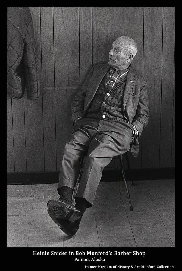 """Image is of Gerrit """"Heinie"""" Snider seated in Bob's Barber Shop in Palmer."""