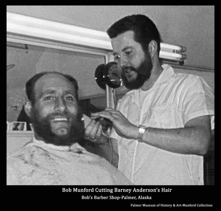 Image is of Bob Munford giving Barney Anderson a haircut in Bob's Barbershop.