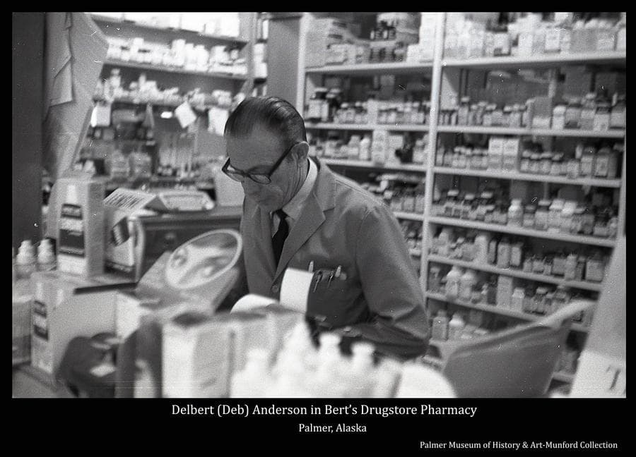 Image is of Delbert (Deb) Anderson, manager of the pharmacy in Bert's Drugstore in Palmer.
