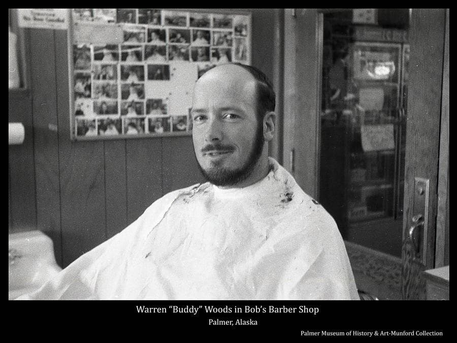 """Image is of Warren """"Buddy"""" Woods sitting for a haircut in Bob's Barber Shop.  Buddy was a well-known local bush pilot flying out of Palmer. The Palmer airport is named in his honor."""