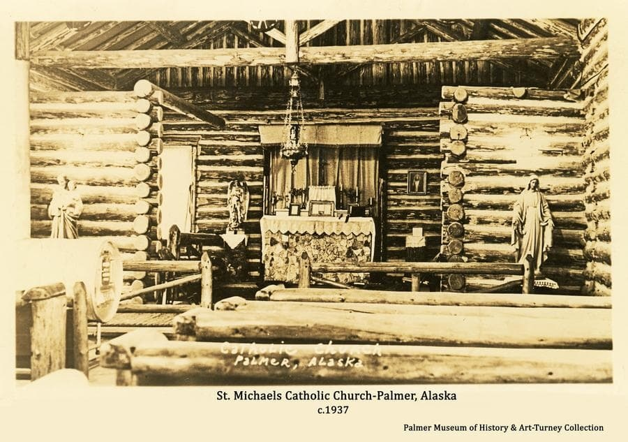 Image is a view of the interior sanctuary of the log St. Michaels Catholic Church in Palmer as it appeared not long after it was construction in 1937.  Statues, pictures and other religious objects are apparent.