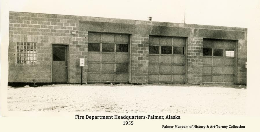 Image is a summer street-side view from W. Evergreen Ave. of the Palmer Fire Department Fire Hall as it appeared in 1955.