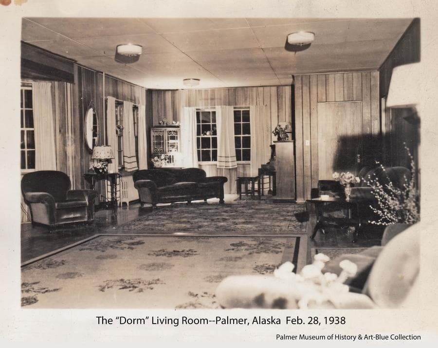 """Interior view of the lobby and living room of the dormitory constructed in the Community Center for single teachers, nurses, corporation employees and others.  Often referred to as the """"Teacher's Dorm"""", it furnished modern living accommodations a social gathering place during the early days of the Colony project when such housing was in very short supply.  Refurbished and modernized, it continues to offer rooms for rent as the privately operated """"Colony Inn""""."""