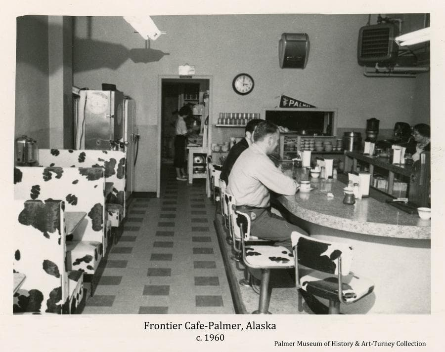 Image is an interior view of the Frontier Cafe in Palmer as it appeared about 1960.