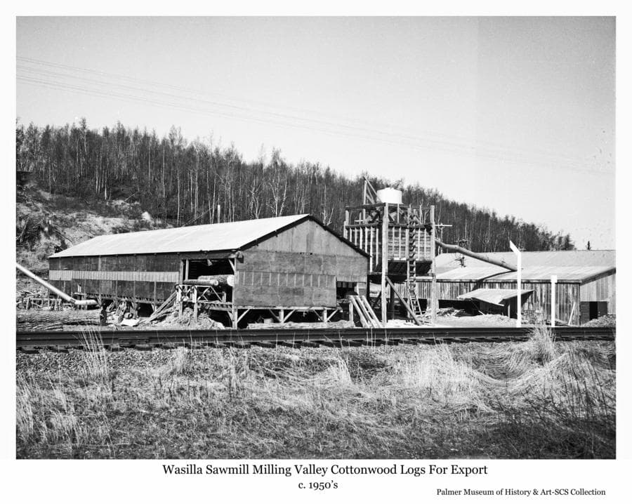 Image is of the Wasilla sawmill established in the 1950's to mill cottonwood logs for export.  It was located in East Wasilla, below the hill later occupied by the Home Depot store, next to the railroad tracks visible in foreground.