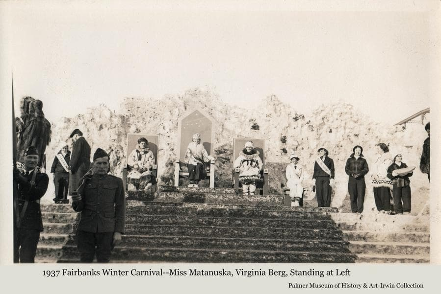 """Image is of the Royal Court at the 1937 Fairbanks Winter Carnival.  Several women and men are gathered.  Miss Virginia Berg of Palmer is the """"Miss Matanuska"""" entry in the festival Queen contest and is seen standing at left between the men.  A military honor guard is present in foreground.  The festival queen is seated at center."""