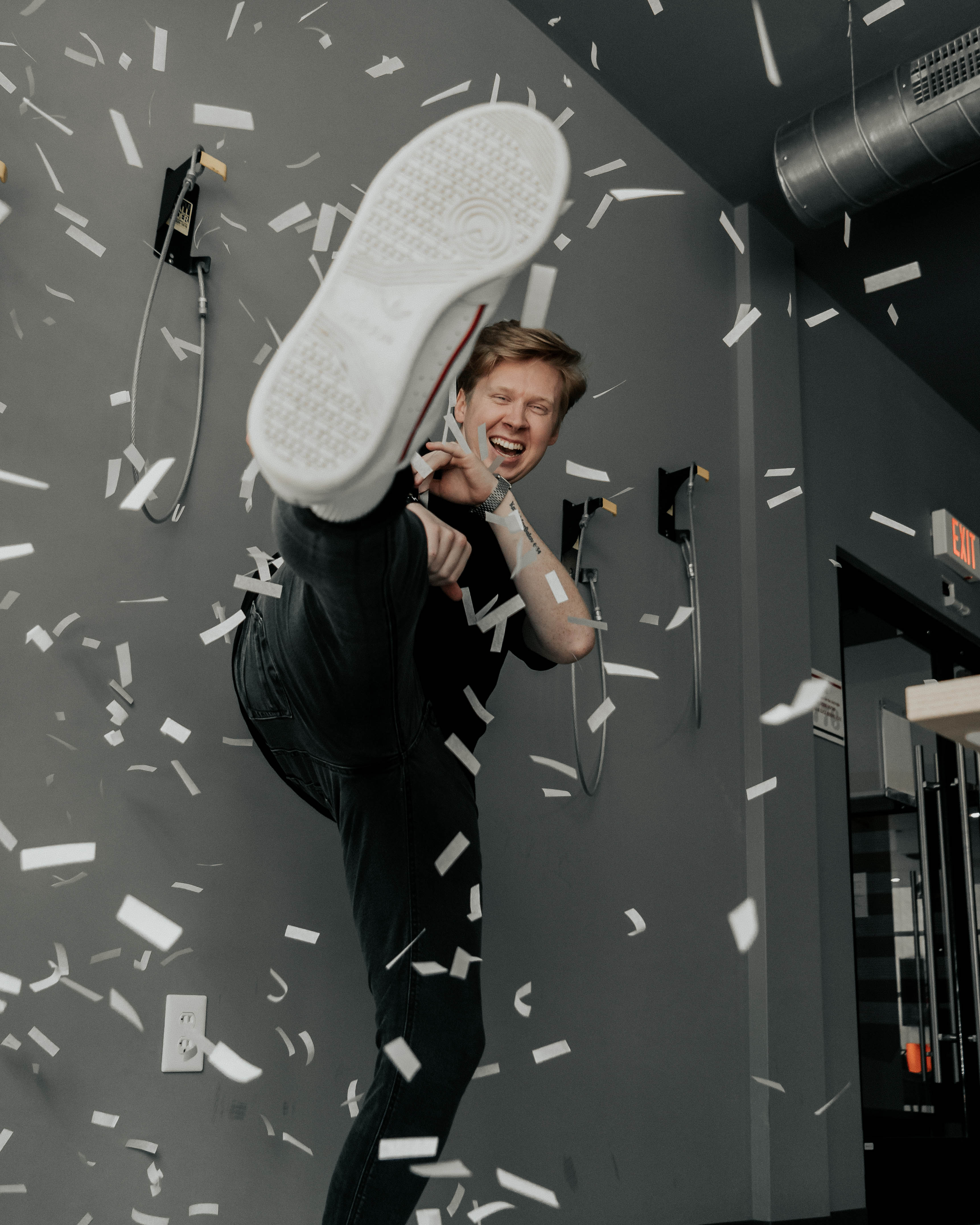 Blair Hoover, Co-Founder and web designer for Hoover Collective kicking confetti